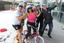 group picture with woman on a bike