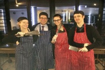 group picture of people in apron