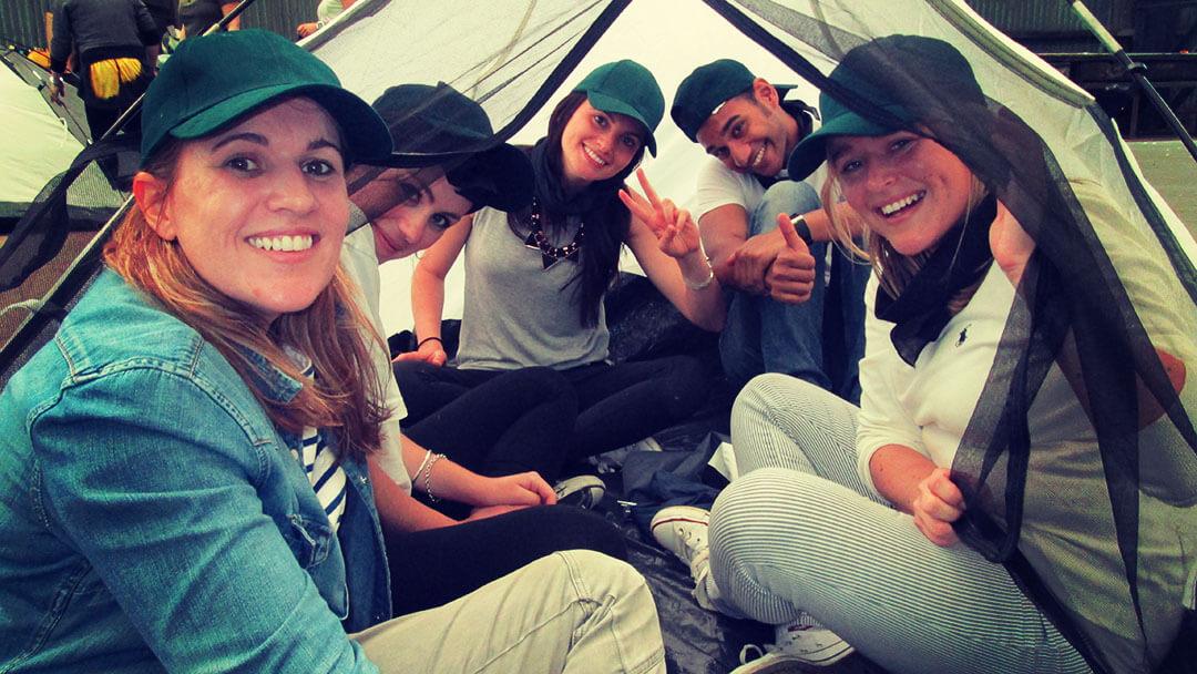 corporate survivor participants on a tent