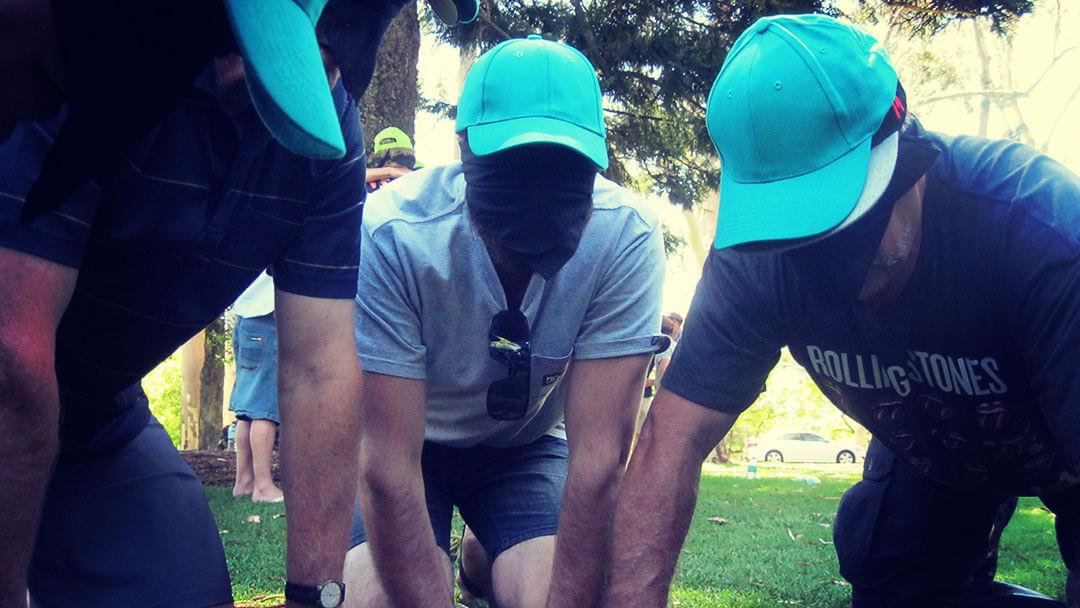 corporate-survivor-blindfolded-men