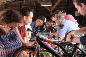 team assembling bikes