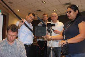 team filming activity