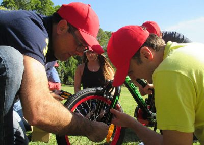 team assembling a bike
