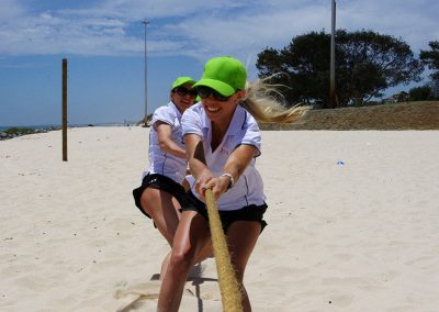 women in tug of war activity