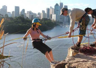 woman on rappel extreme team building activity