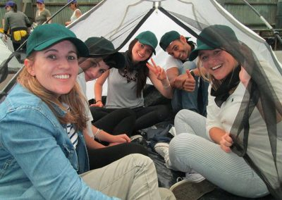 team on tent huddle