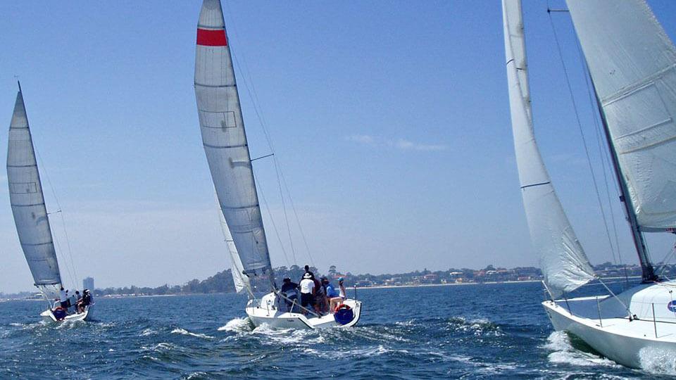 three boats on synergy sailing